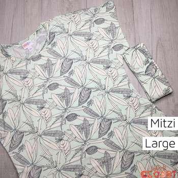 Mitzi (L)